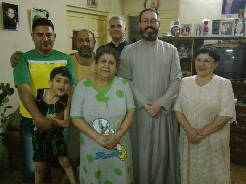 Fr. Luis and Fr. Jorge with a family