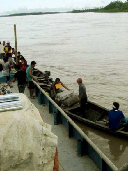 Middle of the river exchange of goods and passengers.