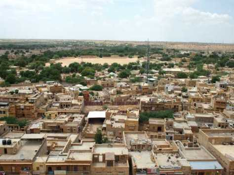 Watching the city of Jaisalmer come alive in the morning.  Daily life starts up above, on the roof.