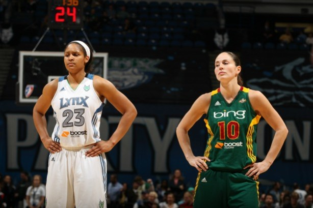 Seattle's Sue Bird (right), seen here next to Minnesota's Maya Moore,  joins ESPN as a WNBA analyst this season as she recuperates from an injury. (David Sherman/NBAE via Getty Images)