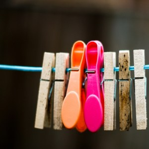 Clothes line with colourful pegs
