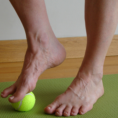 Five-Minute Yoga Challenge with tennis ball