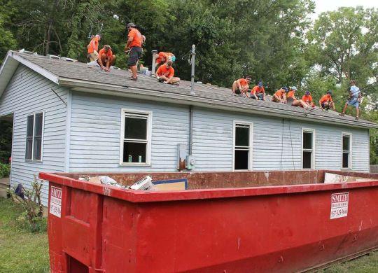 Bicycle Adventurers repair roof in Springfield, Ohio, as summer journey nears end