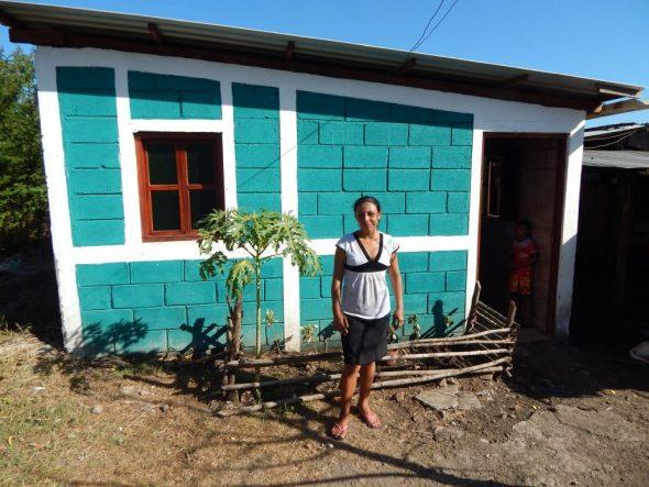 Yasmina, in front of her Fuller Center home in Las Peñitas, Nicaragua