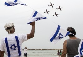 Israelis gather to watch an air show performed by the air force, over the beach in the Mediterranean coastal city of Tel Aviv, on May 6, 2014. AFP PHOTO / JACK GUEZJACK GUEZ/AFP/Getty Images