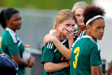 Bethel's Ashley Barnes, center right, comforts Amanda Leslie, center, after Wednesday's game against Poquoson. To the right is Behtel's Ashley Garrett.