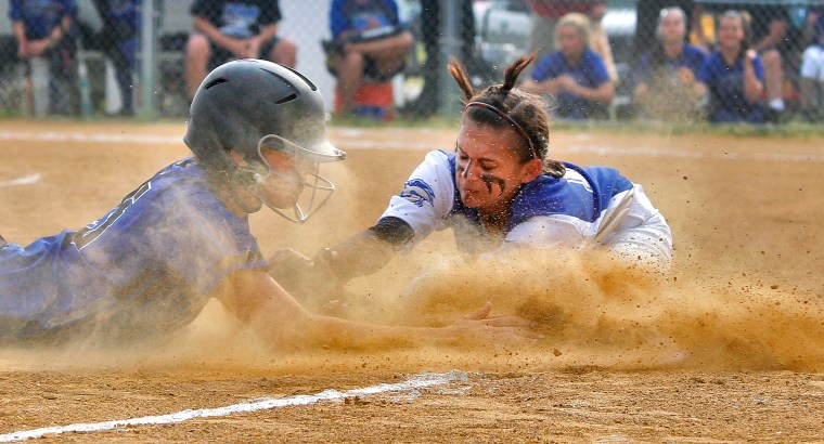 York's Lia Batchelor, left, slides safely into third before the tag from Smithfield's Sam Bauer, right, during Wednesday's game at Smithfield.