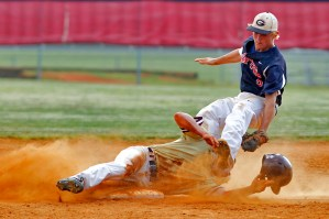 Kings Fork's Duke Santora, left, slides safely into second base while colliding with the foot of Grafton's Spencer Brown during Wednesday's 4A South region baseball semifinals.