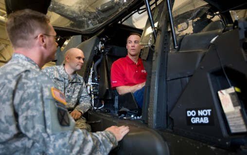 NASCAR driver Kevin Harvick, right, sits in an AH-64 Apache helicopter during a visit to Fort Eustis on Wednesday.