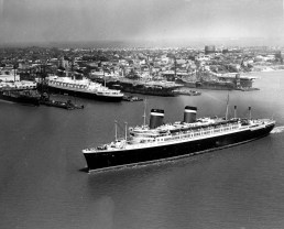 SS America -- Moving slowly toward her dock at the Newport News Shipbuilding, the SS America arrives in May 1952 arrived yesterday for her annual overhauling and repainting by her builders.