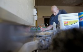Michael Leccadito, 28, washes dishes on his first day with Youth Challenge of Hampton Roads, a non-profit organization which helps those who battle drug addiction and alcoholism. (Kaitlin McKeown)
