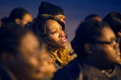 Rita Thornton begins to cry during a vigil for Isaac Oshin outside Majik City Gentlemen's Club and Sports Bar Friday evening. Dozens of people gathered outside the club to remember Isaac Oshin who was shot to death inside the club at 5825 Jefferson Avenue Wednesday evening. (Photo by Jonathon Gruenke/Daily Press)