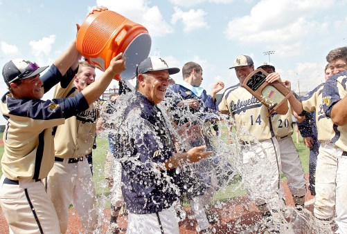 Lafayette coach Rick Schenk gets doused with water after their win over Loudoun Valley 5-4 in the 3A state championship game at Liberty University Saturday.