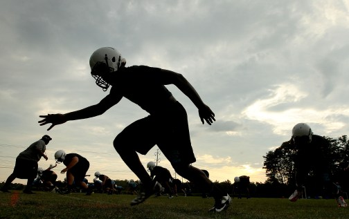 Warhill defensive linemen work on getting their stance right during the first day of practice Thursday at Warhill.
