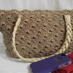Sandstone Colored Rippled Shells Purse with Tan Braided Straps $65.00