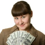 A woman with money that symbolizes the phrase that pays