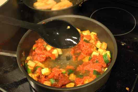 Ladle pasta water into tomato mixture