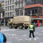The US Army Corps of Engineers drive up Downtown Manhattan to continue their work in draining flooded subway stations.