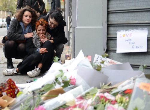 A woman cries near Le Petit Cambodge restaurant, the day after a deadly attack on November 14, 2015 in Paris, France.