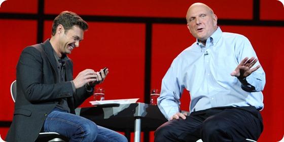 Microsoft CES Keynote host Ryan Seacrest checks out Steve Ballmer's Windows Phone.