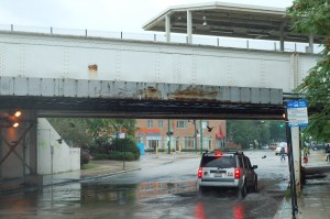 Orange Line elevated train stop at 35th & Archer, Chicago, 10 Sept. 2014   Kenneth Lowe