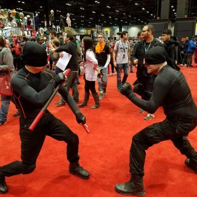 Two cosplayers representing Daredevil Season 1 on Netflix