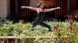 Yoga instructor Fern Trelfa demostrates in the Garden of Mindful Living at the RHS Chelsea Flower Show 2016 in London, UK Monday May 23, 2016. RHS / Luke MacGregor