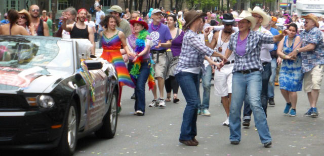 Gays for Pasty folk dance along the Boston Gay Pride Parade route in 2014