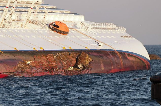 Rock embedded in the port side of the damaged hull of the Costa Concordia.