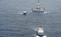 The Kulluk drilling rig under tow by the MV Aiviq (front) 80 miles southwest of Kodiak City, Alaska, on Saturday, December 29, 2012, shortly after the Aiviq began experiencing engine problems. U.S. Coast Guard Photo