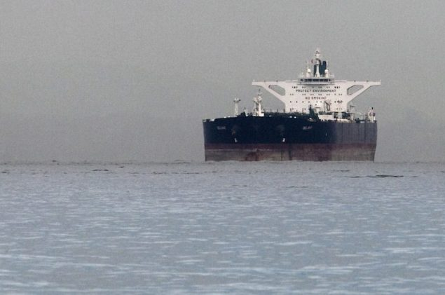 "Malta-flagged Iranian crude oil supertanker ""Delvar"" is seen anchored off Singapore in this March 1, 2012 file photo. (c) REUTERS/Tim Chong"