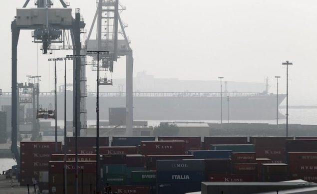 A cargo ship is anchored outside the Port of Long Beach, California December 4, 2012. REUTERS/Mario Anzuon