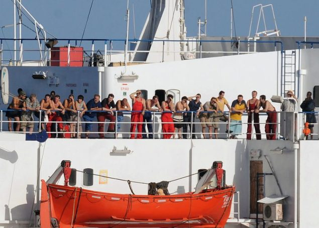 The crew of the MV Faina on deck after a U.S. Navy request to check on their health and welfare.