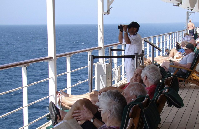 A watchkeeper is seen on the deck of Queen Mary 2 in the Southern Red Sea January 24, 2013. (c) REUTERS/Eva Tomsic