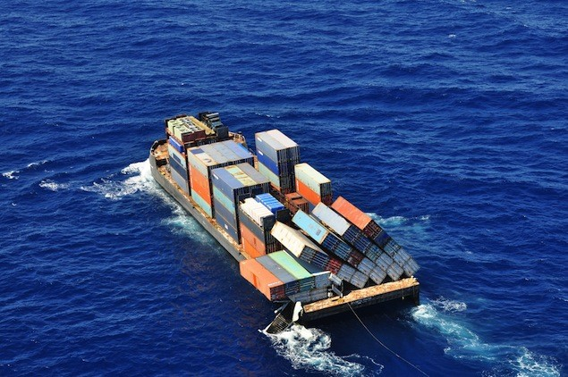 """The barge Atlantic Trader seen with its cargo toppled """"like a bunch of dominoes."""" U.S. Coast Guard Photo"""