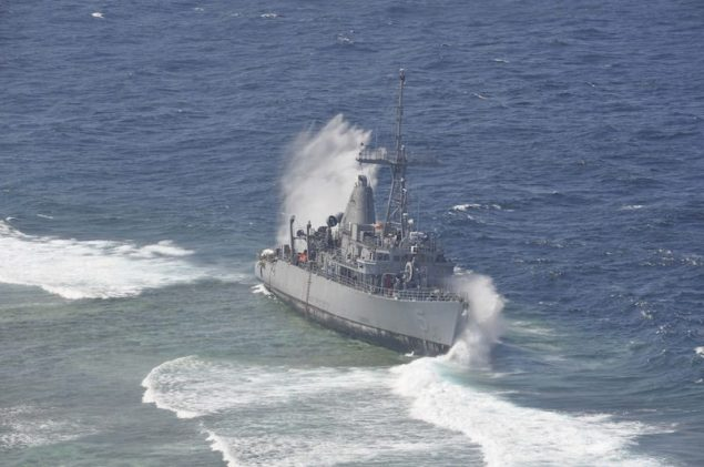 Heavy waves crash against the grounded mine countermeasure ship USS Guardian (MCM 5), which ran aground on the Tubbataha Reef in the Sulu Sea on January 17, 2013. U.S. Navy Photo