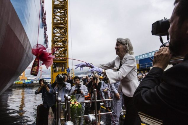 Ane Mærsk Mc-Kinney Uggla breaks a bottle against the vessels hull during the official naming ceremony. Image courtesy Maersk Line