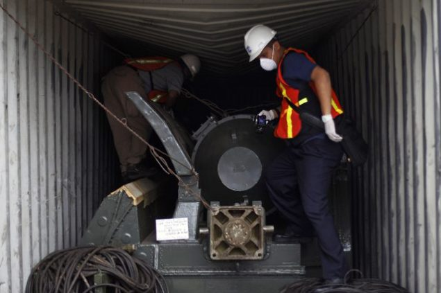 "Panama forensic workers work in a container holding a green missile-shaped object seized from the North Korean flagged ship ""Chong Chon Gang"" at the Manzanillo Container Terminal in Colon City July 17, 2013. (c) REUTERS/Carlos Jasso"