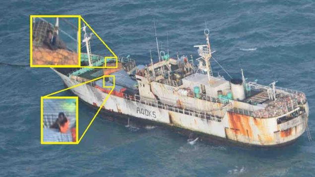 Suspected pirates on board the FV Naham 3 point their weapons at an EUNAVFOR helicopter. Photo: EUNAVFOR