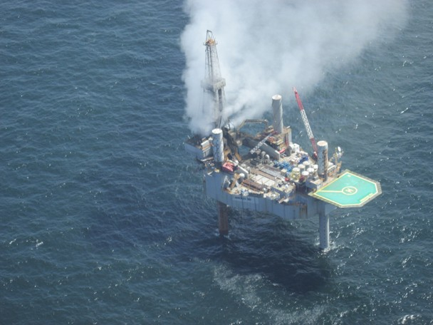 The Hercules 265 drilling rig pictured is jacked-up over the smaller unmanned platform, as is typical during drilling operations. The platform is not visible. The cloud pictured is natural gas from the well. Photo: BSEE