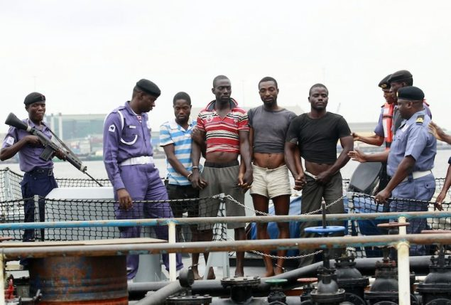Rare Occurrence: Suspected pirates are paraded aboard a naval ship after their arrest by the Nigerian Navy at a defence jetty in Lagos August 20, 2013. REUTERS/Akintunde Akinleye