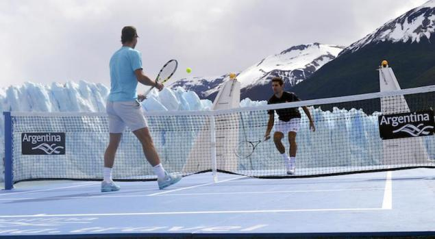 "Handout shows Djokovic of Serbia and Nadal of Spain playing exhibition tennis match on court set up on deck of ""Argentino Supply"" cargo ship, as Perito Moreno glacier is seen in background"