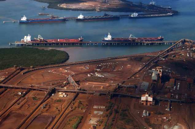 Ships waiting to be loaded with iron ore are seen at the Fortescue loading dock located at Port Hedland, in the Pilbara region of Western Australia December 3, 2013. REUTERS/David Gray