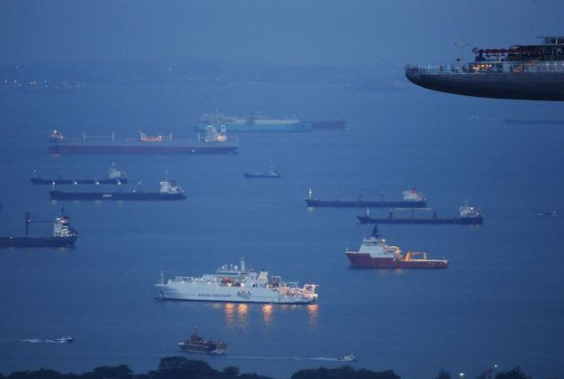 Ships at anchor near the Port of Singapore. Picture taken July 17, 2013. REUTERS/Edgar Su
