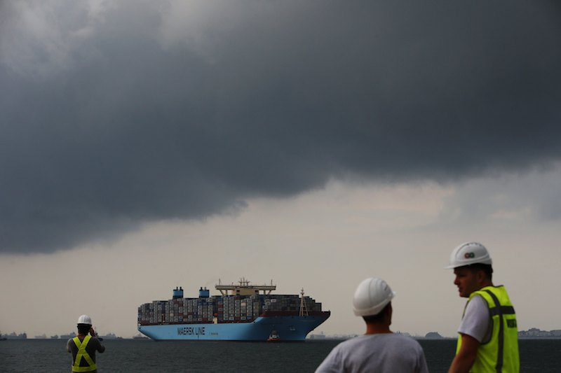 The MV Maersk Mc-Kinney Moller is led by pilot ships as it makes its maiden port of call at a PSA International port terminal in Singapore