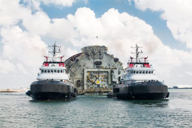 Three of Crowley's ocean class tugs, Ocean Wind, Ocean Wave and Ocean Sun, towed the 605-foot long, 110-foot wide spar from Corpus Christi, Texas, to Keathley Canyon Block 875, about 300 miles offshore.