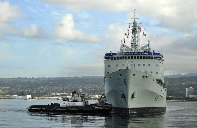 Tug boats assist in the return of the Royal Canadian Navy auxiliary oil replenishment ship HMCS Protecteur (AOR 509)to Joint Base Pearl Harbor-Hickam. U.S. Navy Photo