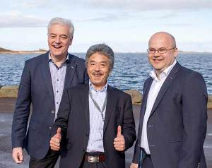 The four ocean going tugs will be constructed at Niigata, Japan. Their project manager, Shigeru Morioka (middle), was present at the contract announcement at Ulstein Design & Solutions in Norway on Monday. To the left in the photo is Sigurd Viseth, managing director UDS, to the right, area sales manager Ove Dimmen, UDS. Photo courtesy Ulstein Group