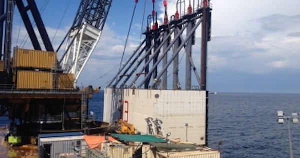 The new sponson, known as S13, is positioned into place using the crane barge