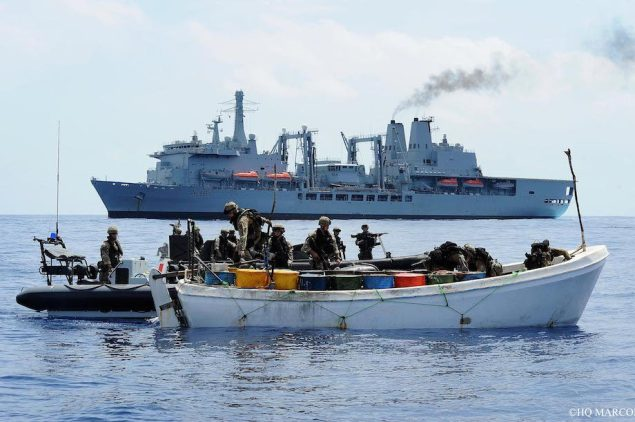 A NATO boarding team inspects a suspected pirate skiff off the Horn of Africa. File photo courtesy NATO.